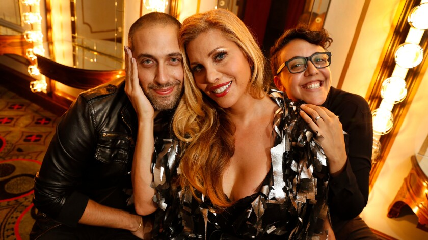 """Cesar Hawas and Carly Usdin, right, are producers of """"Le Bal: A Drag Extravaganza,"""" happening at the Theatre at Ace Hotel on Friday. Actress Candis Cayne, center, is the host."""