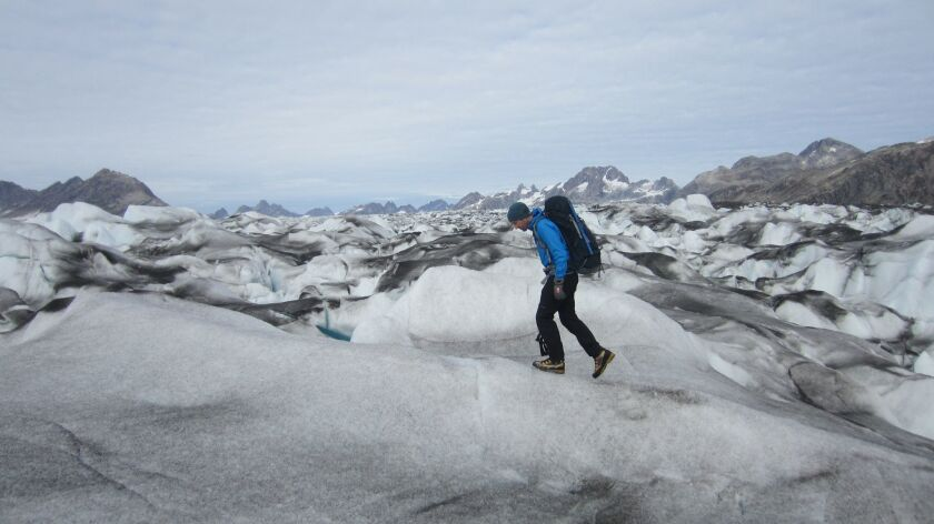 "A photograph of Robert McFarlane at the Knud Rasmussen Glacier in East Greenland for his book ""Under"