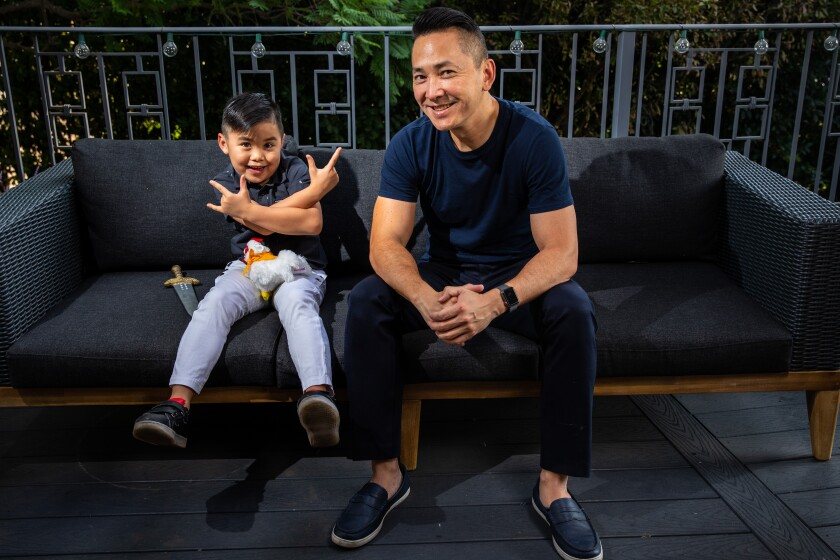 Viet Thanh Nguyen with his son Ellison in the backyard of their Pasadena home.