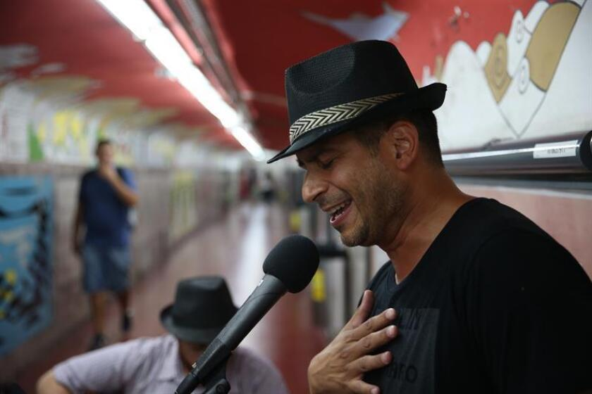 Argentine cardiovascular surgeon Yamil Ponce (r.) and musician Leonardo Facundo (c.) play a tango number in the Pueyrredon subway station of Buenos Aires on Jan. 31, 2018; on in his brief time off, the surgeon switches his scalpel for a microphone to become a street tango singer. EFE-EPA/Tono Gil