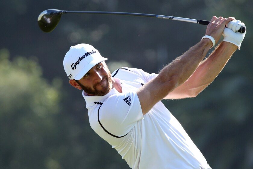 Dustin Johnson watches his shot during the first round of the Northern Trust Open at the Riviera Country Club in Pacific Palisades on Feb. 13, 2014.
