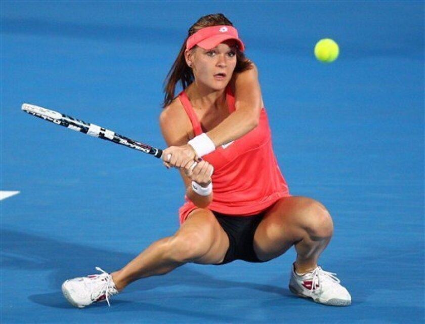 Agnieszka Radwanska of Poland plays a shot to Dominika Cibulkova of Slovakia during their women's final match at the Sydney International tennis tournament in Sydney, Australia, Friday, Jan. 11, 2013. Radwanska won the match 6-0, 6-0. (AP Photo/Rick Rycroft)