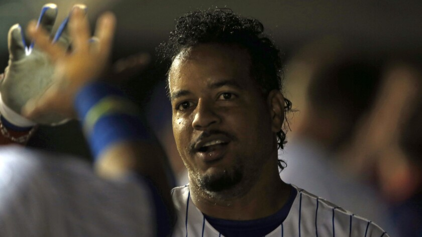 Former Dodgers outfielder Manny Ramirez is congratulated by one of his Iowa Cubs teammates during a game in Des Moines, Iowa, on June 30. Ramirez has struggled during his time with the Cubs.