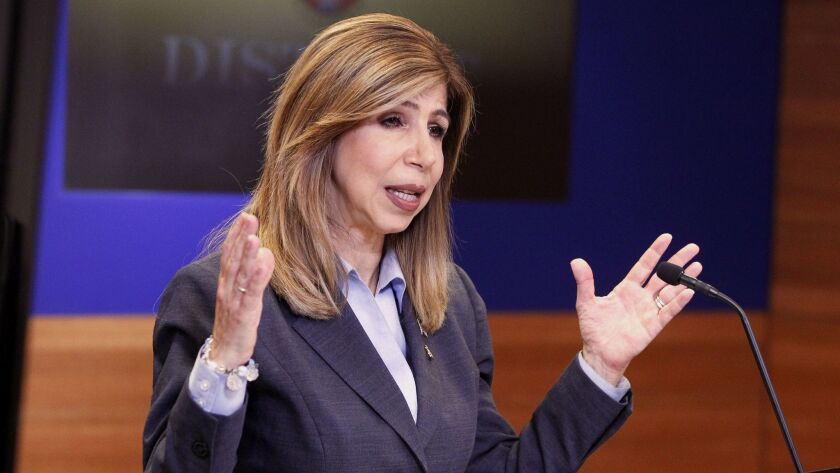 San Diego District Attorney Summer Stephan talks to members of the media during a news conference about her office's review of four separate officer-involved shootings.