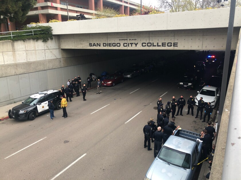 Police gather near San Diego City College after a car plowed into homeless encampment on March 12.
