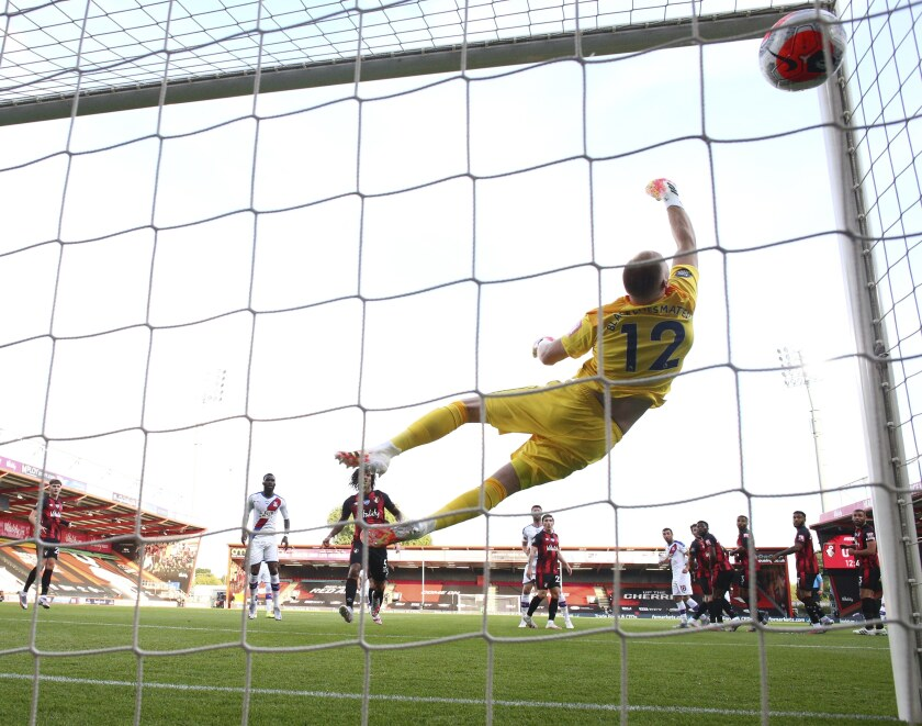Bournemouth's goalkeeper Aaron Ramsdale fails to stop a shot from Crystal Palace's Luka Milivojevic for the opening goal during the English Premier League soccer match between Bournemouth and Crystal Palace at Vitality Stadium in Bournemouth, England, Saturday, June 20, 2020. (AP Photo/Ian Walton, Pool)