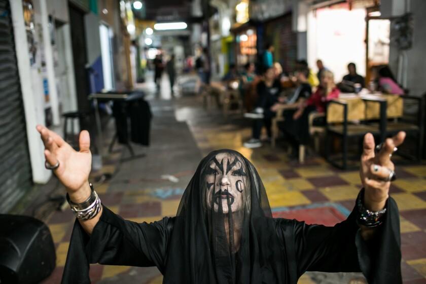 El Muertho poses in Tijuana's Pasaje Rodriguez