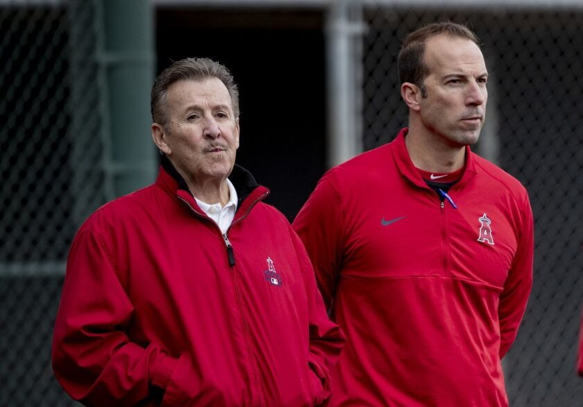 Angels owner Arte Moreno, left, and general manager Billy Eppler watch batting practice during spring training Feb. 18, 2019