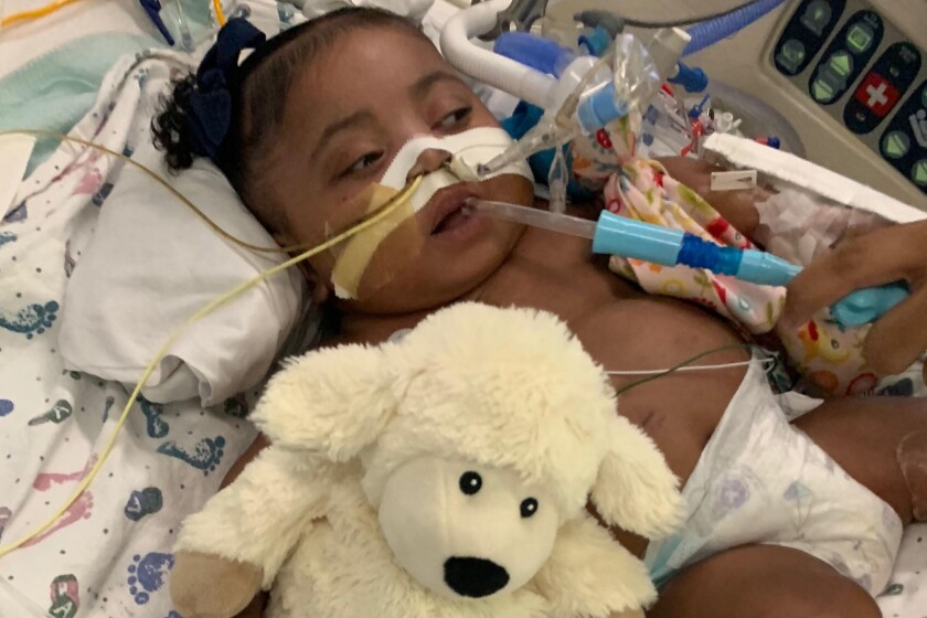 "This undated photo provided by Texas Right to Life shows Tinslee Lewis. After a hospital's plans to remove the 9-month-old girl from a ventilator against her family's wishes were halted, a spotlight is once again on the Texas law that gives families who disagree with doctors 10 days to find a new facility before life-sustaining treatment is withdrawn. Doctors at Cook Children's Medical Center in Fort Worth planned to stop treatment Sunday, Nov. 10, 2019, for Tinslee Lewis after invoking the state's so-called ""10-day rule,"" but a judge granted her family a temporary restraining order that gives them until Nov. 22 to find a place that will take her, said Texas Right to Life spokeswoman Kimberlyn Schwartz. (Courtesy of Texas Right to Life via AP)"