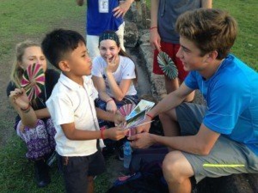 Rancho Santa Fe resident Colton Bancroft (right) interacted with school children in Cambodia on a recent trip through Pacific Ridge School.