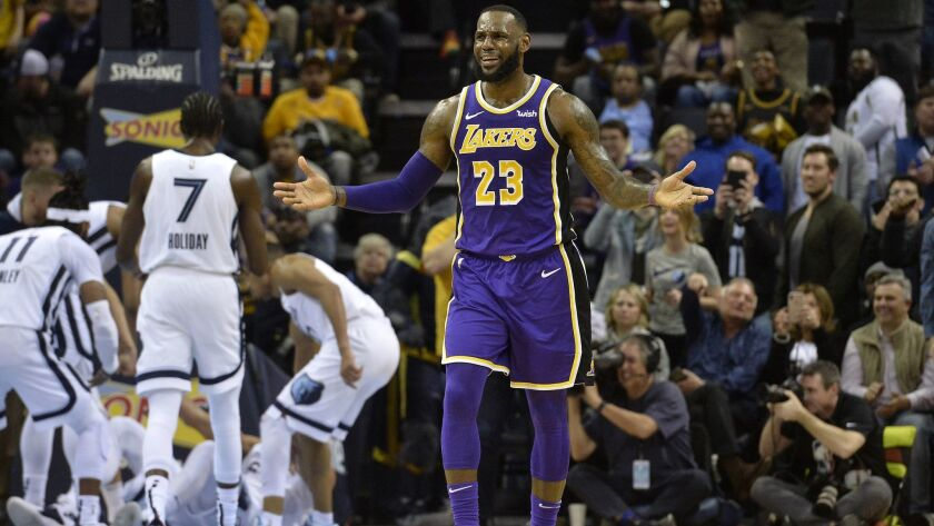 Lakers' LeBron James (23) reacts to an offensive-charge call late in the fourth quarter.