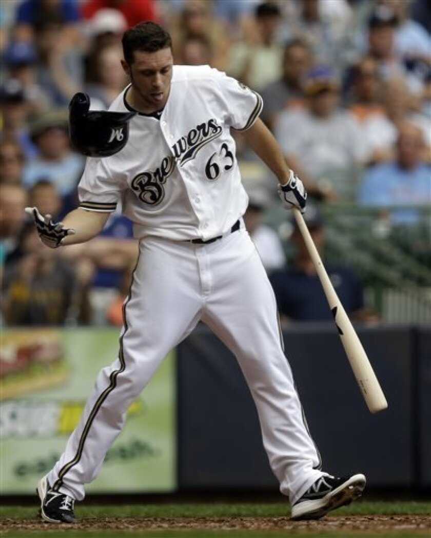 Milwaukee Brewers' Tyler Thornburg loses his helmet as he srikes out with bases loaded during the fourth inning of a baseball game against the Pittsburgh Pirates Monday, Sept. 2, 2013, in Milwaukee. (AP Photo/Morry Gash)