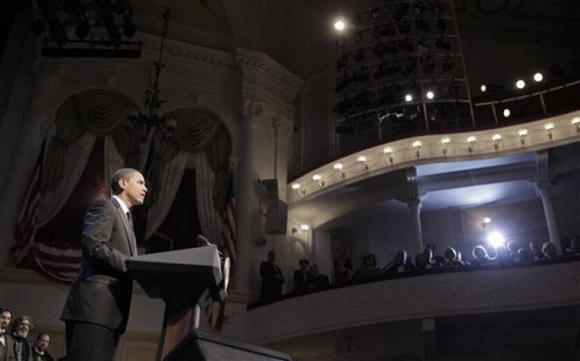 President Barack Obama pauses as he speaks during a visit to Ford's Theater to mark the Abraham Lincoln bicentennial Wednesday, Feb. 11, 2009 in Washington. The box where Lincoln was assassinated is in the background. (AP Photo/Evan Vucci)