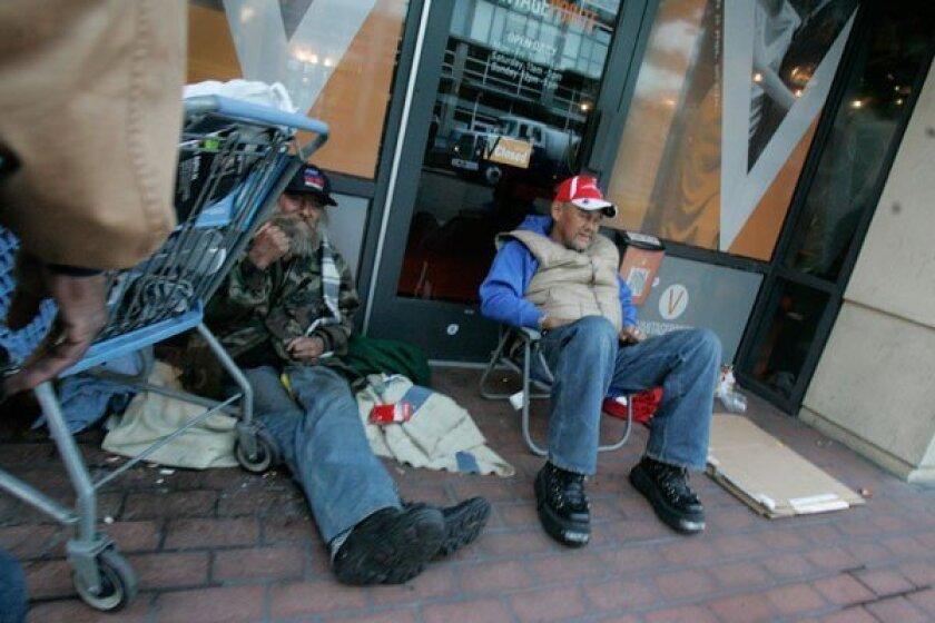 Two homeless men in downtown San Diego.  (John Gibbins / Union-Tribune)