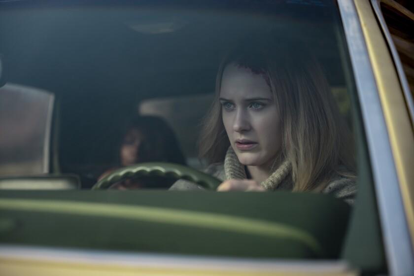 "Marsha Stephanie Blake, background left, and Rachel Brosnahan appear in a scene from the film ""I'm Your Woman."" (Wilson Webb/Amazon Studios via AP)"