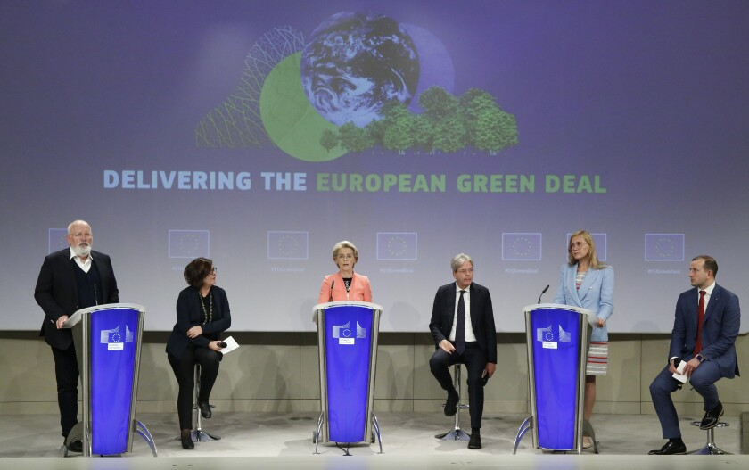 European Commission leaders onstage at a news conference
