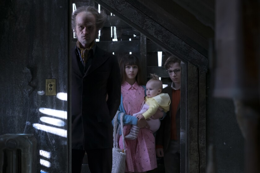"Neil Patrick Harris, left, Malina Weissman and Louis Hynes in ""Lemony Snicket's A Series of Unfortunate Events"" on Netflix."