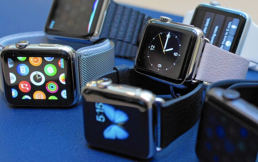 An assortment of Apple's new watch are displayed in London.