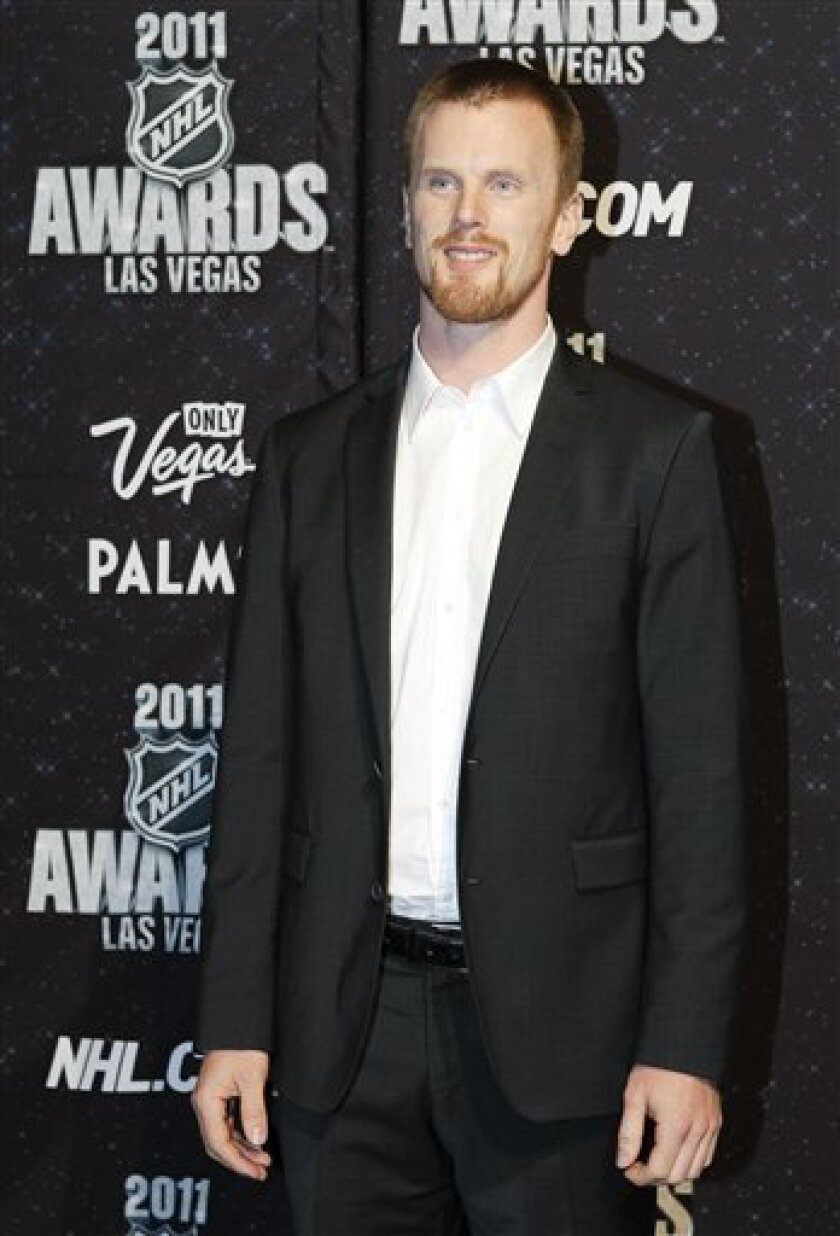Vancouver Canucks Daniel Sedin is photographed on the red carpet before the 2011 NHL Awards, Wednesday, June 22, 2011, in Las Vegas. Sedin was awarded the Art Ross Trophy for the player who leads the league in scoring at the end of the regular season. (AP Photo/Julie Jacobson)