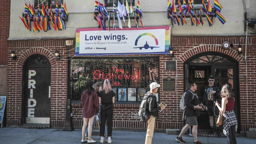 In this Monday, June 3, 2019, photo, pride flags and pride colors display on the Stonewall Inn bar,