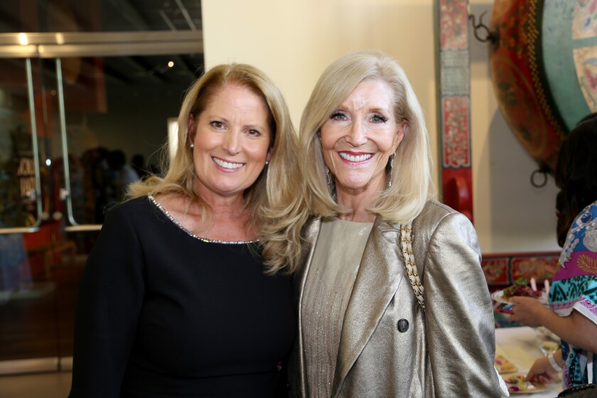 Table for 10 founder Kristin Martin and title sponsor Mary Murfey are shown at the dinner event held at Bowers Museum.