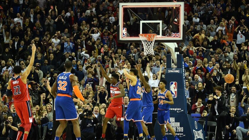 Players react after a goaltending call at the end of the NBA London Game between Washington Wizards and New York Knicks at the O2 Arena.