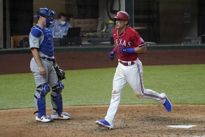 Dodgers catcher Will Smith watches as Texas Rangers' Derek Dietrich crosses the plate.