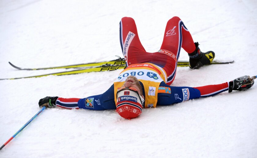 Norway's Martin Johnsrud Sundby lies on the ground after the men's 10km competition at the FIS Cross-Country World Cup in Falun, Sweden, Saturday Feb. 13, 2016. (Maja Suslin/TT via AP) SWEDEN OUT