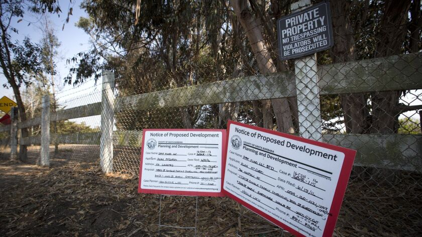 GAVOTA, CA -- THURSDAY, AUGUST 4, 2016: Notices of proposed development are posted at the Santa Bar