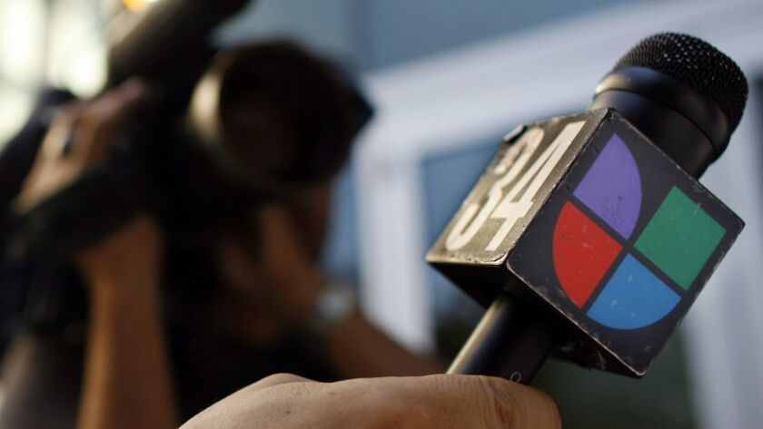 A microphone bearing the logo of Spanish-language broadcaster Univision.