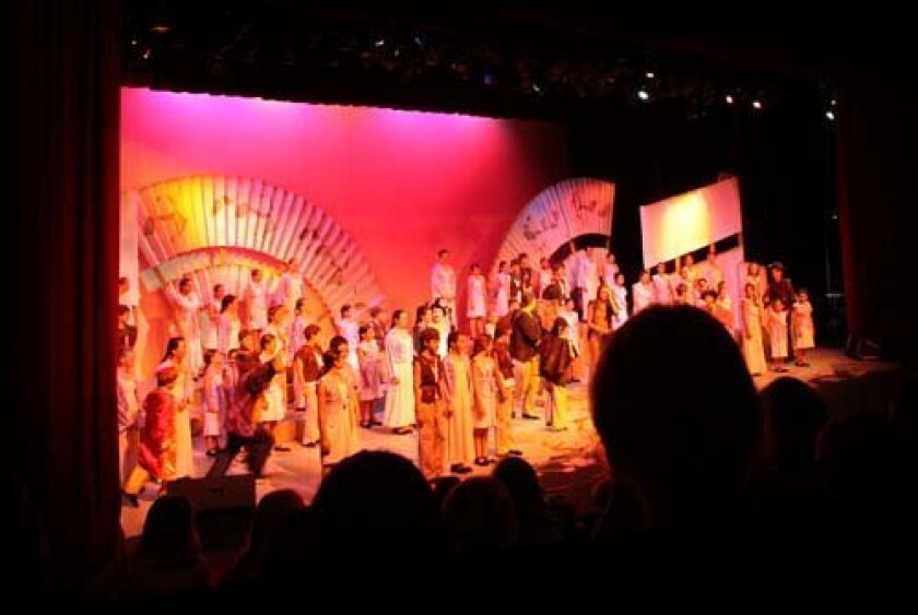 A colorful scene from the play. Pearl Preis photo