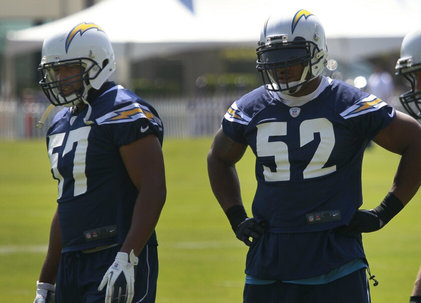 Linebackers Jonas Mouton, left, and Larry English, right, during the first day of Chargers training camp, where a handful of other veterans were also in attendance.