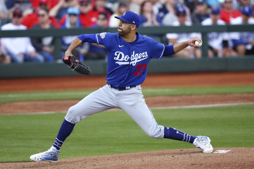 Los Angeles Dodgers starting pitcher David Price throws a pitch against the Cincinnati Reds.