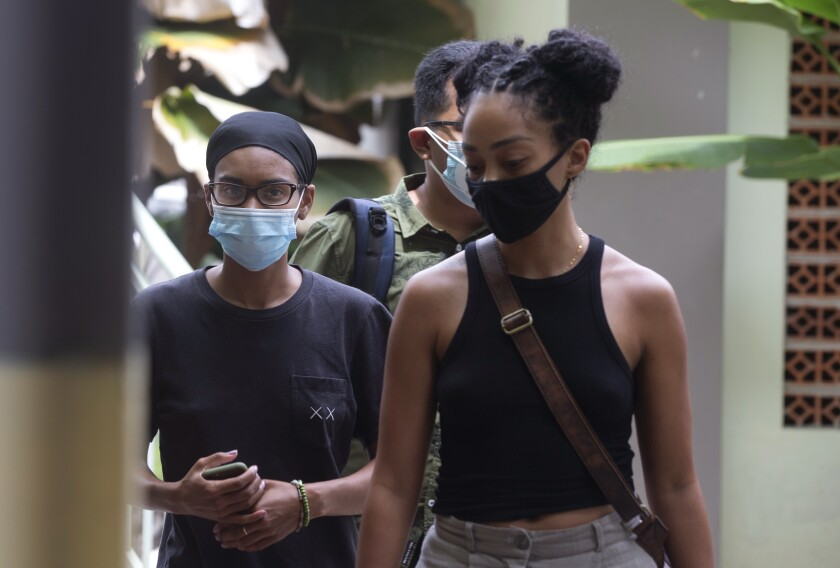 Kristen Antoinette Gray and her partner get tested for the coronavirus at a hospital in Bali, Indonesia.