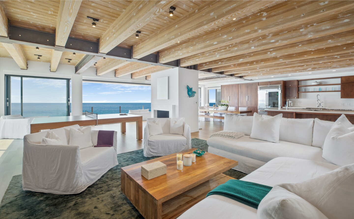 The architectural beach house expands to two levels of wood decks overlooking the ocean.