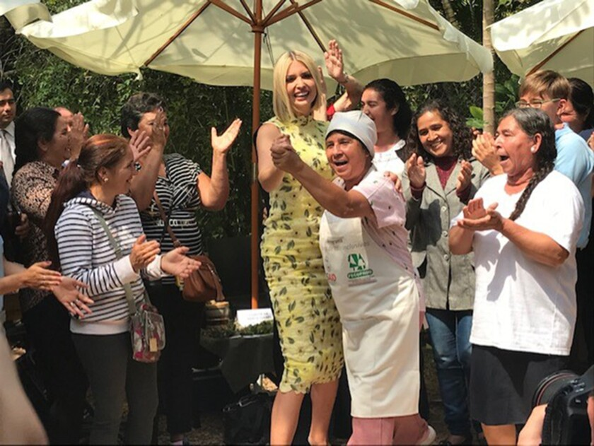 Ivanka Trump dances with a market vendor in Asuncion, Paraguay, earlier this month during a three-nation tour through South America promoting women's empowerment.
