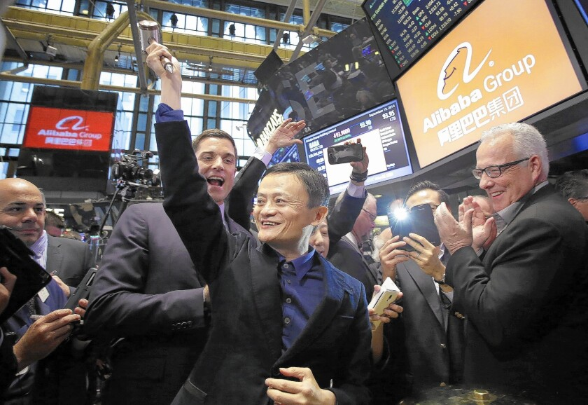 Jack Ma, center, Alibaba's chairman, smiles Friday while touring the New York Stock Exchange. Alibaba was founded in 1999 by a group of 18 people, led by Ma.