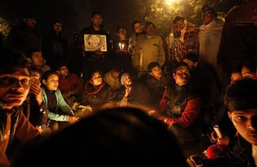 Indians gather for a candlelight vigil Thursday in memory of a gang-rape victim in New Delhi. Prosecutors say they will seek the death penalty against five men charged in the assault and try them in a fast-track court.