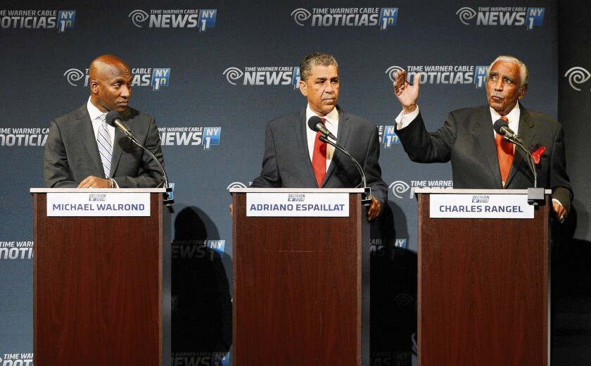 Rep. Charles Rangel, right, gestures during a debate with state Sen. Adriano Espaillat, center, and the Rev. Michael Waldrond Jr. Polls show Rangel leading Espaillat by several points and both far ahead of Walrond.