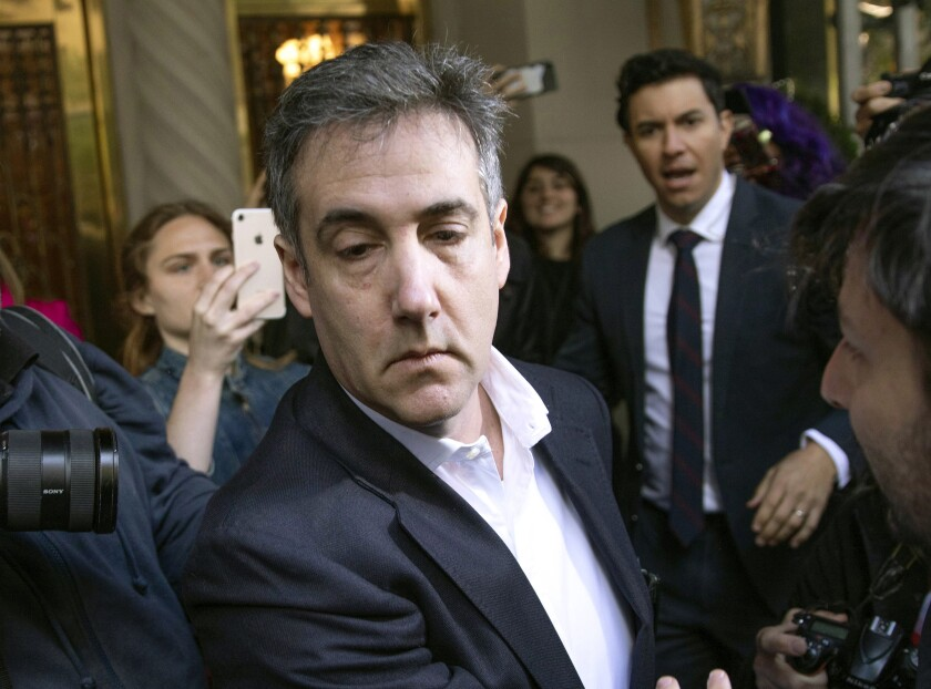 FILE - In this May 6, 2019, file photo, Michael Cohen, former attorney to President Donald Trump, leaves his apartment building before beginning his prison term in New York.l Cohen, was returned to federal prison, weeks after his early release to serve the remainder of his sentence at home because of the coronavirus pandemic, the federal Bureau of Prisons said Thursday, July 9, 2020. (AP Photo/Kevin Hagen, File)