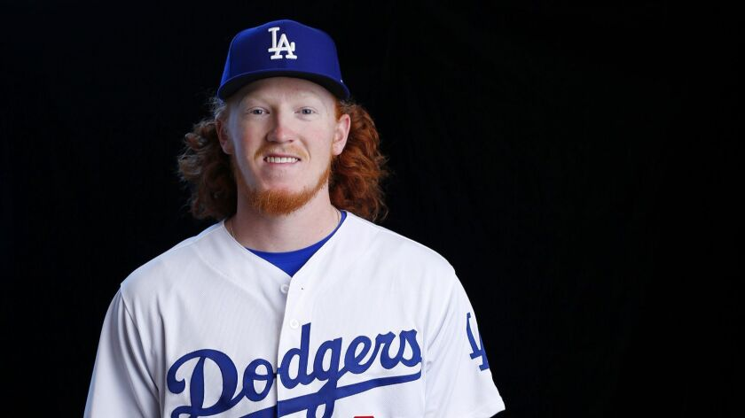 Dustin May is a top pitching prospect and manager Dave Roberts says he might make the major leagues this season.