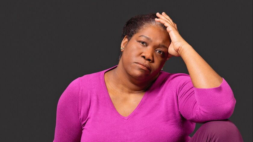 Exhausted mature black woman in pain