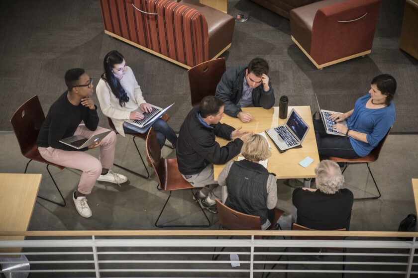 Students at Stanford University's Hacking 4 Diplomacy meet outside a classroom.