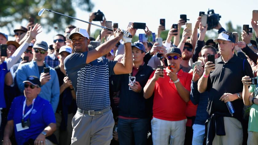 A crowd gathers around Tiger Woods in Friday's second round of the Farmers Insurance Open at Torrey Pines North. Tiger, at one under par, made the cut to play in the final two days of the tournament.