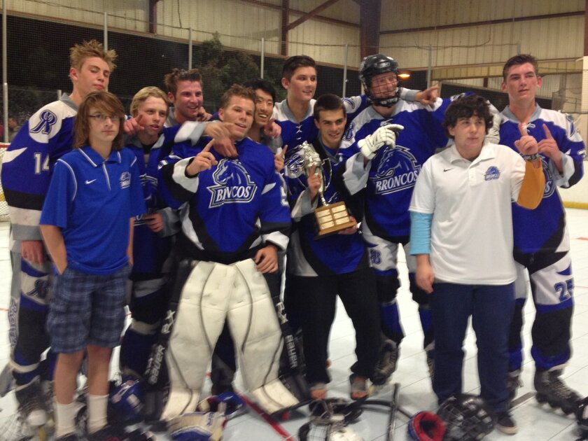 The Rancho Bernardo roller hockey team celebrates a perfect season after beating Cathedral Catholic 3-1 in the Metro Conference championship game.