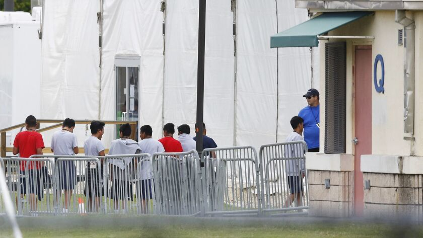 Immigrant children outside the Homestead Temporary Shelter for Unaccompanied Children, a former Job Corps site that now houses them, on Wednesday, June 20, 2018, in Homestead, Fla.