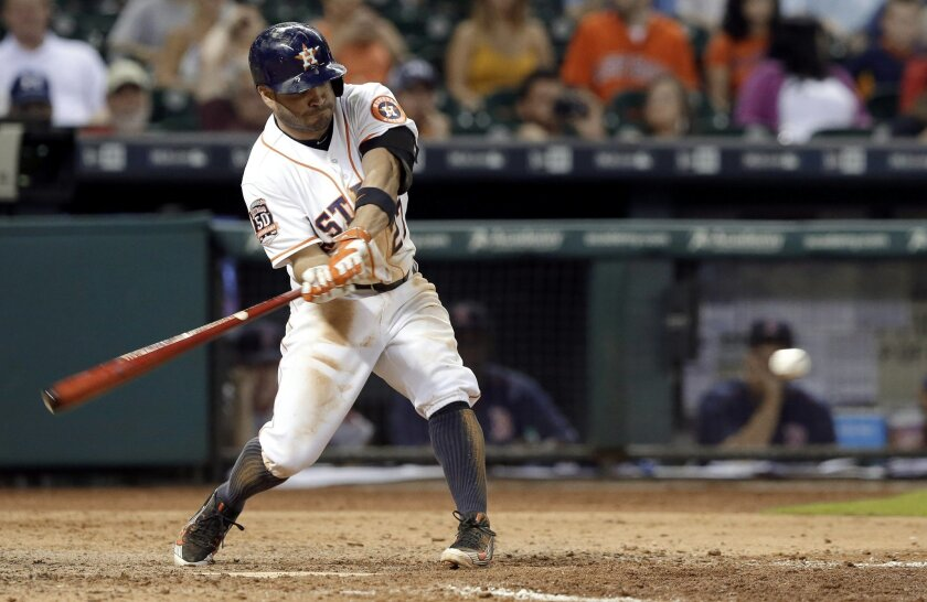 Houston Astros' Jose Altuve swings for a walk-off home run to beat the Boston Red Sox 5-4 in the ninth inning of a baseball game Thursday, July 23, 2015, in Houston. (AP Photo/Pat Sullivan)