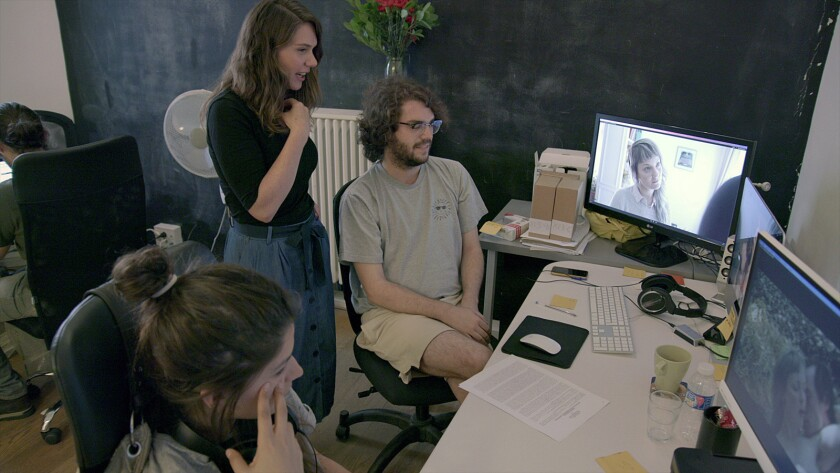 """Pornographer Erika Lust (standing) works on a project in her Barcelona offices in an episode from the Netflix documentary series """"Hot Girls Wanted: Turned On."""""""