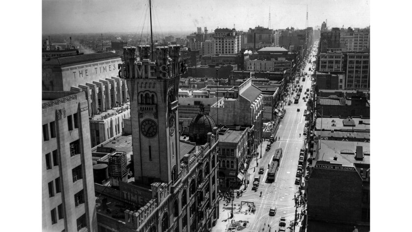 May 4, 1936: In a rooftop view looking down Broadway, the third Los Angeles Times building dominates the intersection at First Street. The current Times building is in left, background.