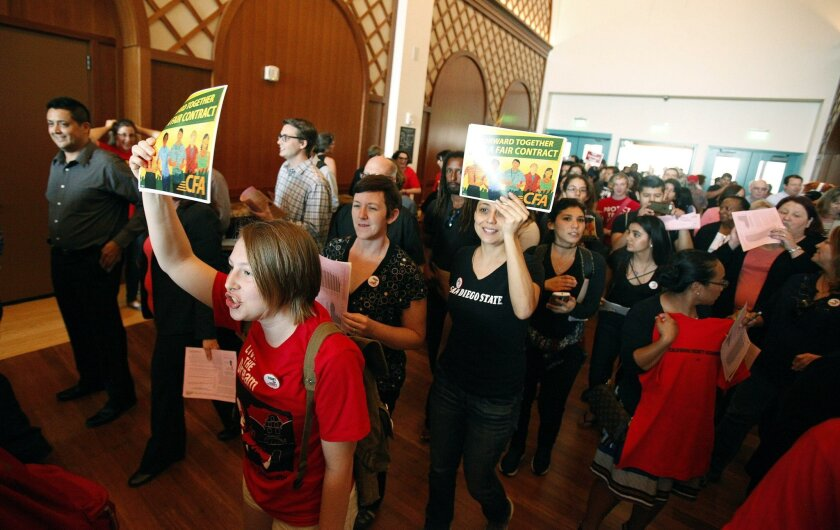 San Diego State University faculty members and supporters rallied in the lobby before a forum with California State University Chancellor Timothy White at Montezuma Hall on Wednesday.